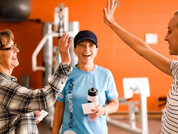 Participants high five in cancer and exercise program in the Thrive Centre